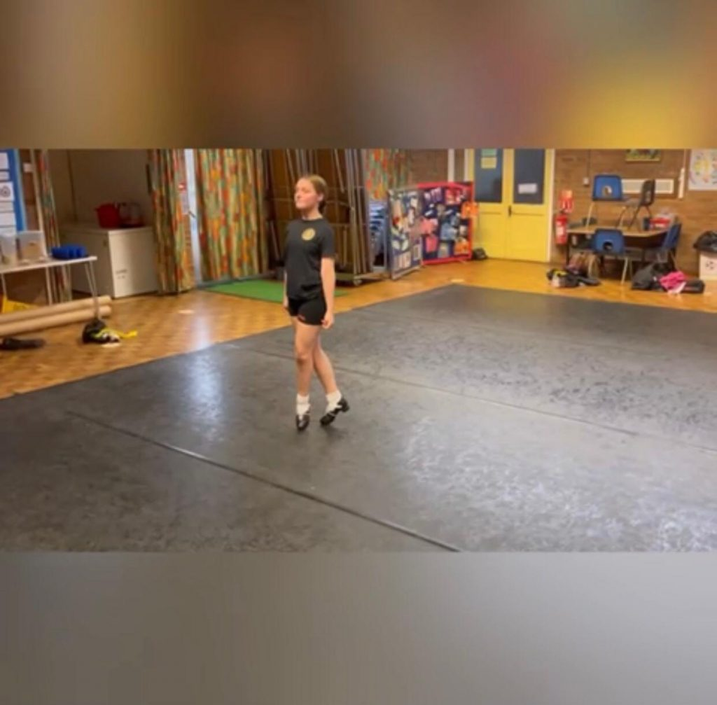 A traditional Irish dancer practicing on harlequin flooring at our Oxford studio