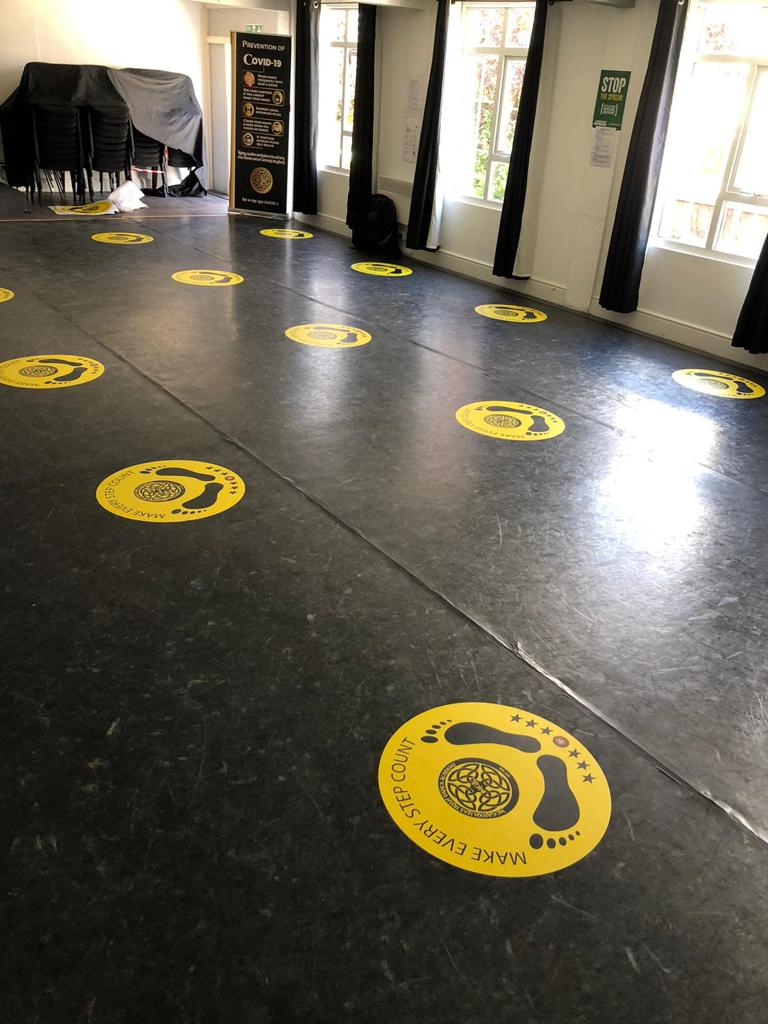 """Harlequin dance floor featuring """"Make every step count"""" markers"""